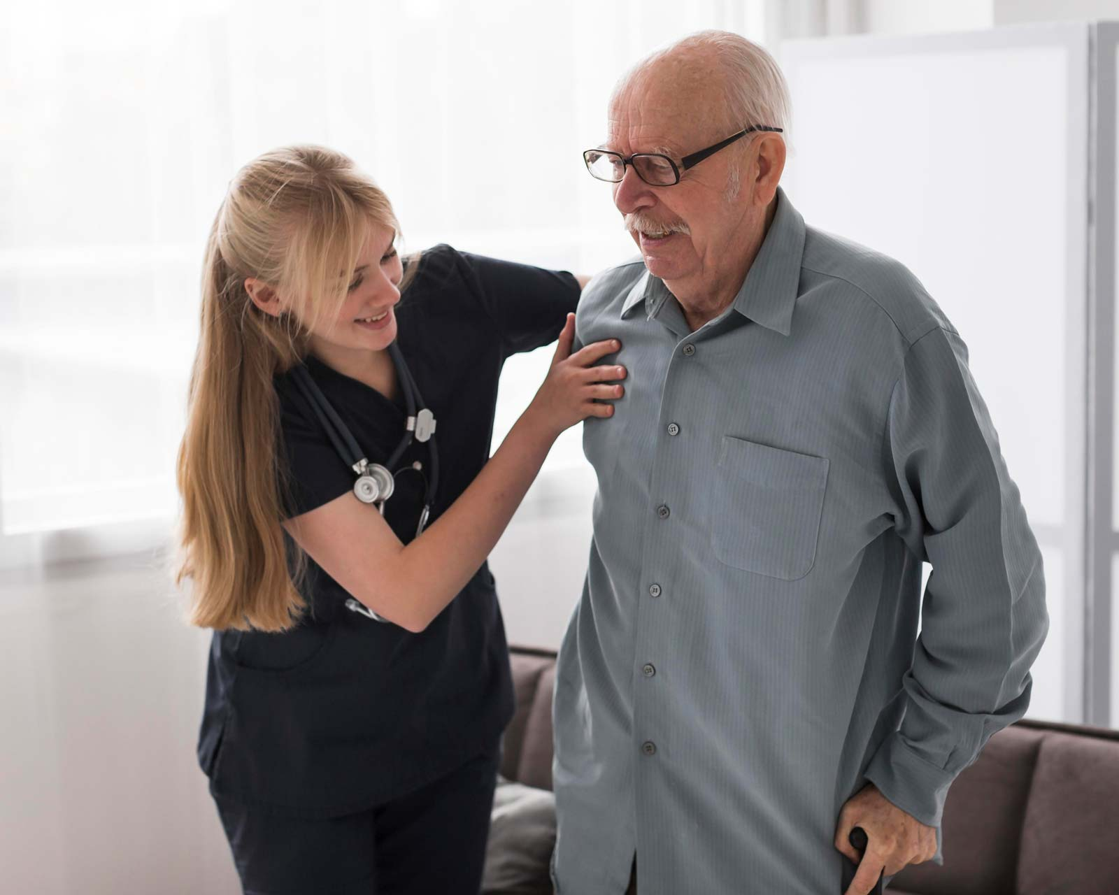 nurse-helping-old-man-stand-up